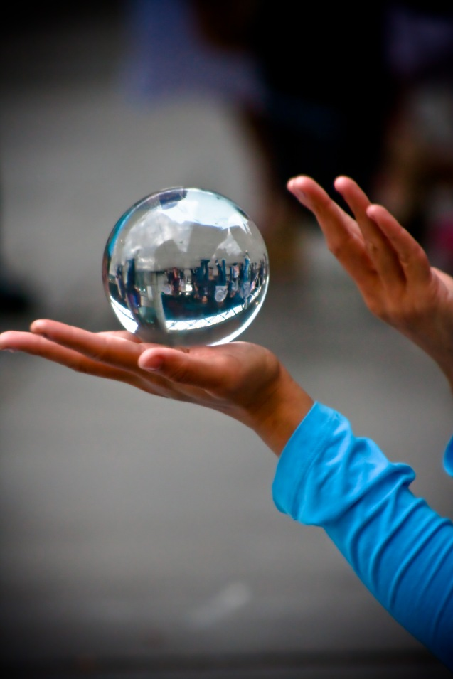 Reflections in a crystal ball. Captured on London's South Bank. Source.